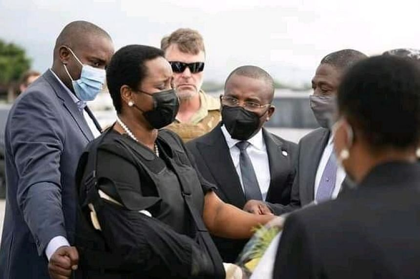 Mrs Martine Moise (left) is greeted by Mr Claude Jospeh in Port-au-Prince, Haiti, on July 17, 2021.