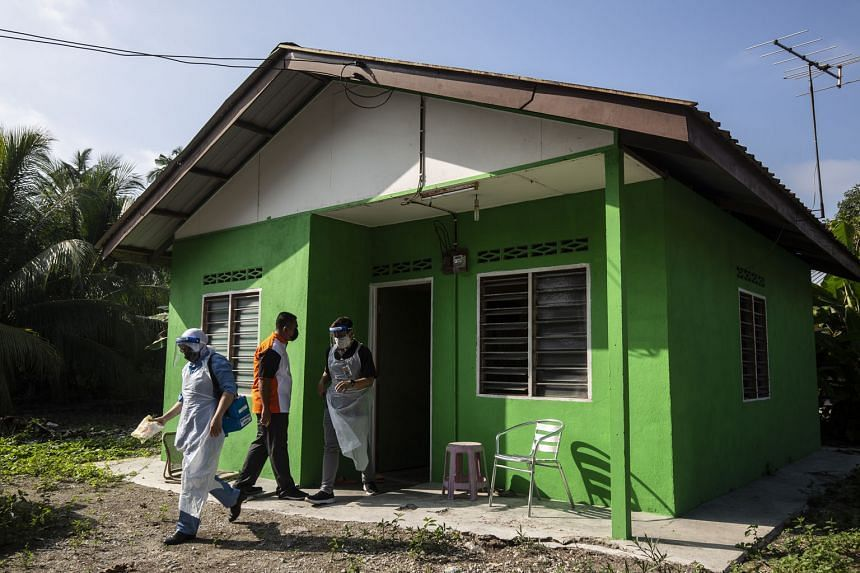 Malaysian health workers leaving after completing their vaccination job at a house in Kuala Langat, outside Kuala Lumpur, on July 17, 2021.