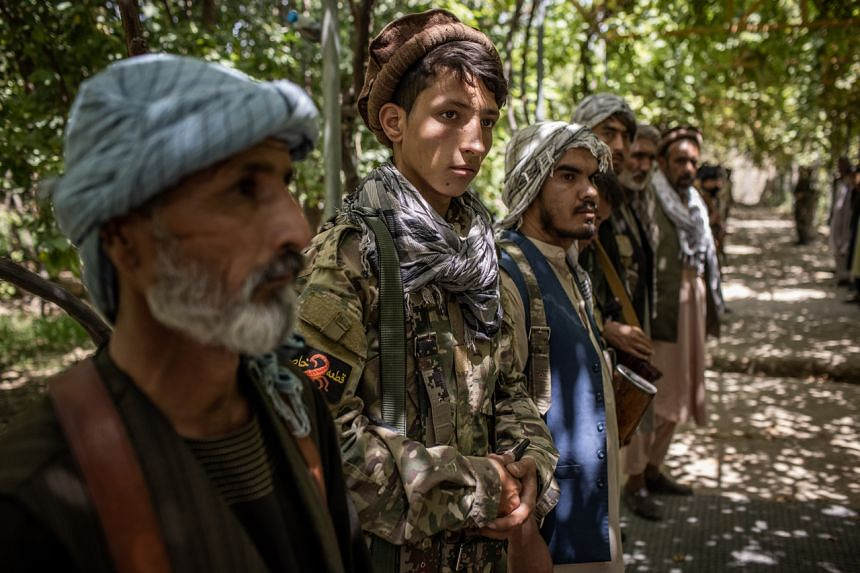 Mr Omid Wahidi (second from left) with other militia recruits at a compound near Mazar-e-Sharif, Afghanistan, July 11, 2021.