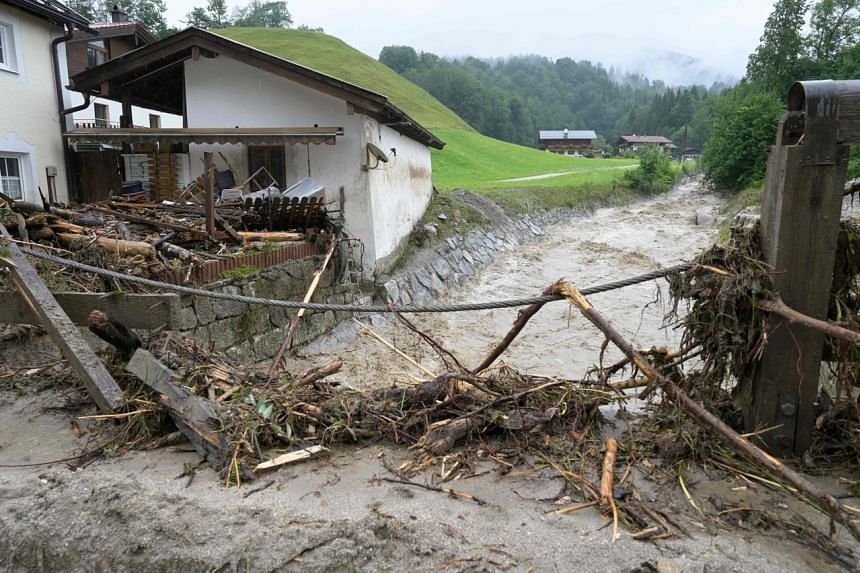 Debris in front of a house near a river, after heavy rainfall and flood caused major damage in Berchtesgaden, Bavaria, on July 18, 2021.