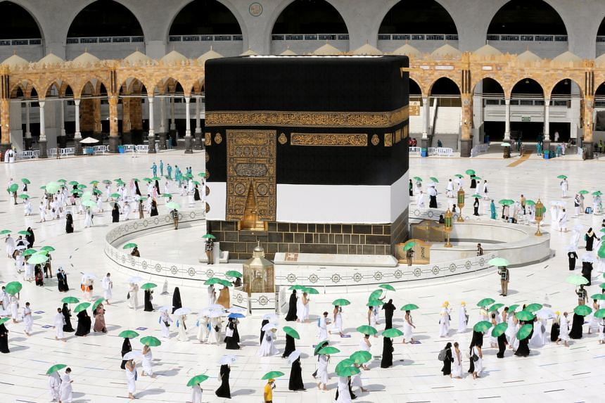 Muslim pilgrims circle the Kaaba in the Grand Mosque in Mecca, Saudi Arabia, on July 17, 2021.