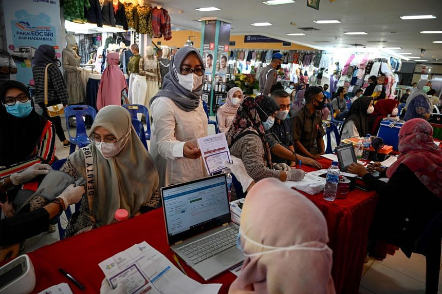 People registering to receive a dose of the Sinovac vaccine at a shopping centre in Banda Aceh, the capital of Aceh province, yesterday. PHOTO: AGENCE FRANCE-PRESSE