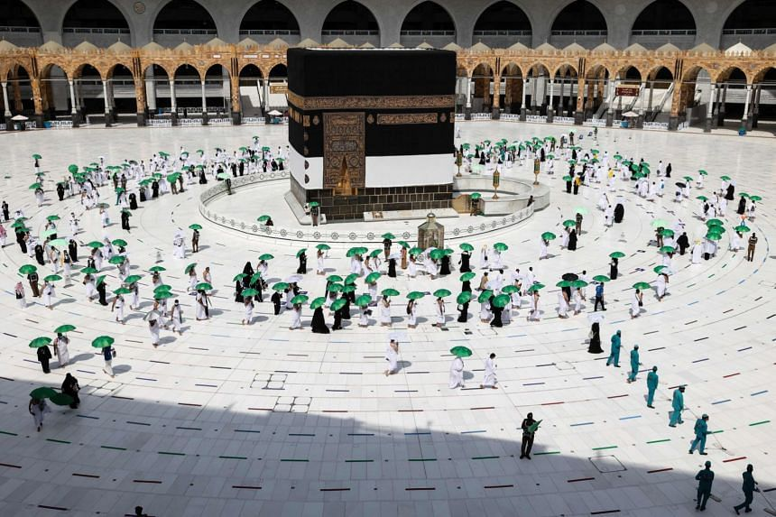 Pilgrims arrive at the Kaaba, Islam's holiest shrine, at the Grand Mosque in the holy city of Mecca, on July 17, 2021.