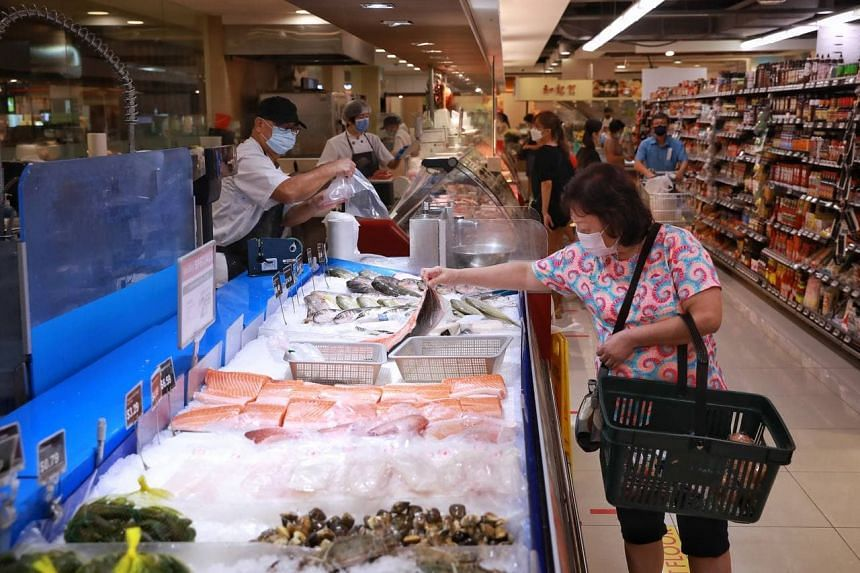 A shopper browsing at the fresh seafood section of the Cold Storage in Heartland Mall on July 18, 2021.