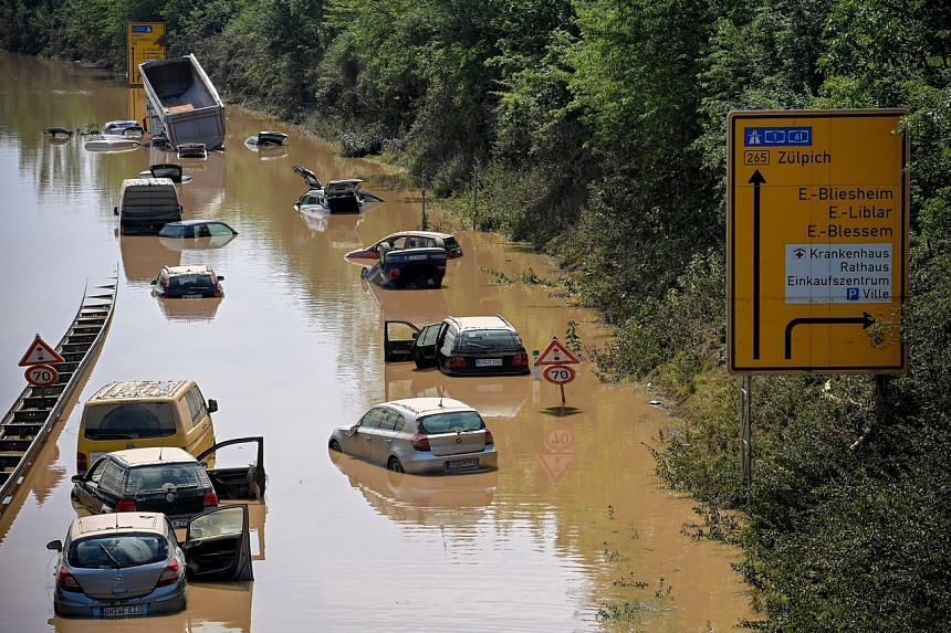 Wrecked vehicles on a flooded highway after heavy, continuous rain in Erftstadt, Germany, on July 17, 2021.
