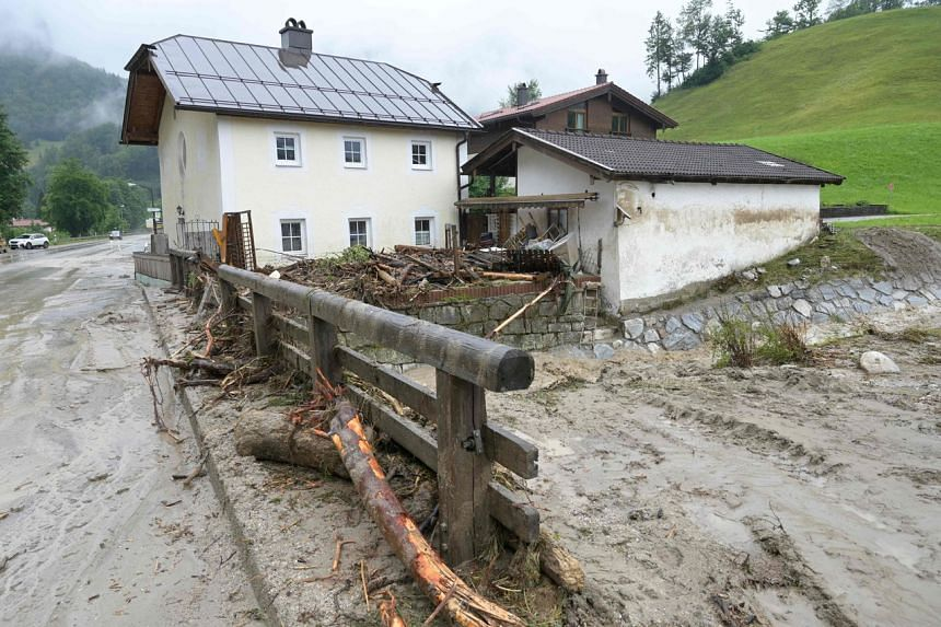 Debris and mud next to a house after heavy rainfall and flood caused major damage in Berchtesgaden, Bavaria, on July 18, 2021.