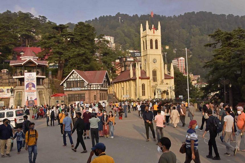 Domestic tourists wandering around the ridge area of Shimla in Himachal Pradesh state, India, on July 6, 2021.