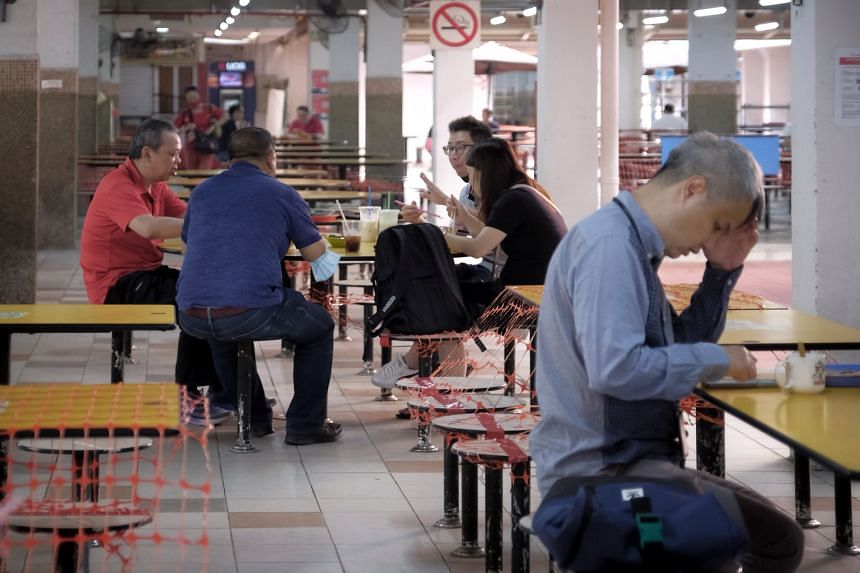People in not more than groups of five having breakfast at People's Park Food Centre on July 12, 2021.