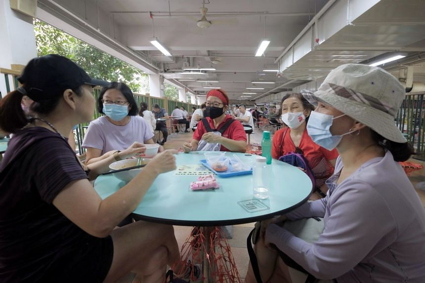 A group of five friends having breakfast at Hong Lim Food Centre after their morning walk, on July 12, 2021.
