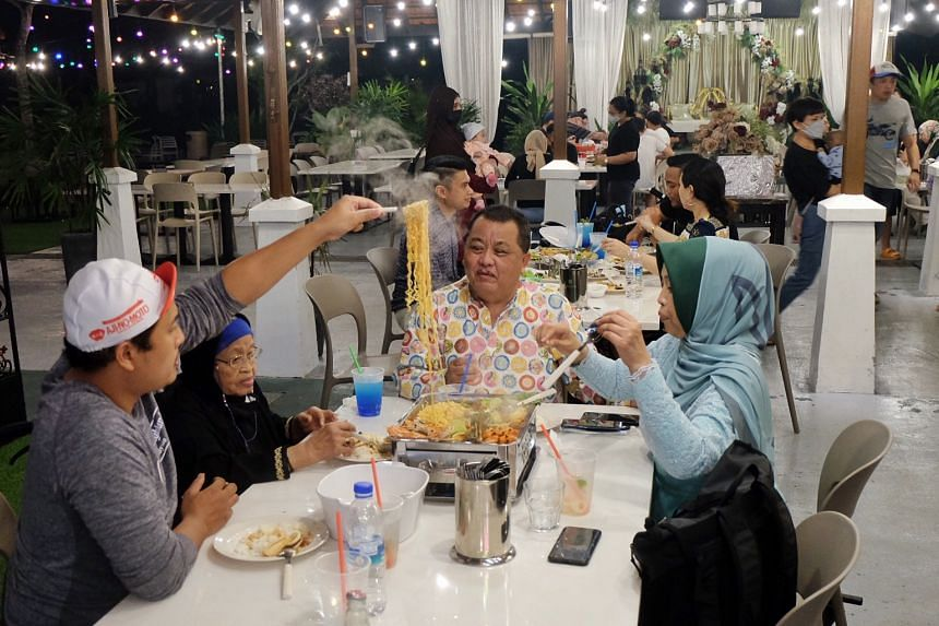 Diners tucking in during dinner at restaurant 555 Halal Thai at Gallop Kranji Farm Resort on July 15, 2021.