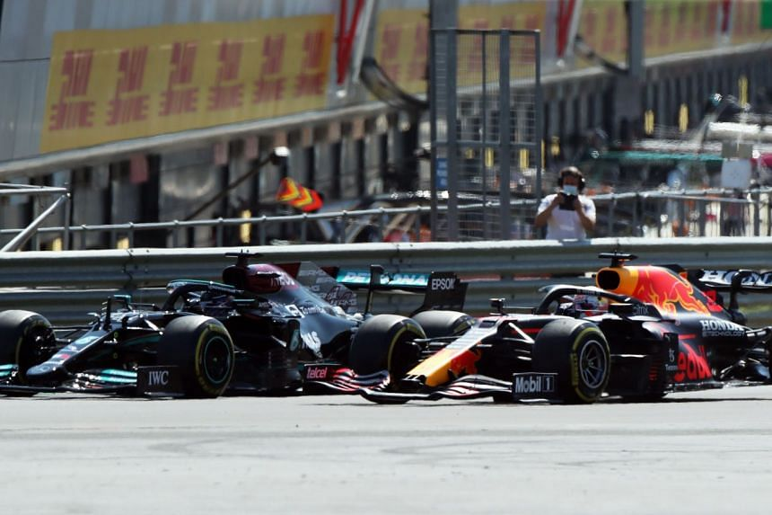 Mercedes' Lewis Hamilton, who started second on the grid, chasing down Red Bull's Max Verstappen before the Dutchman hit the front tyre of the Mercedes and crashed out of British Grand Prix at Silverstone on July 18, 2021.