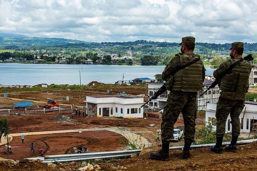 Philippine soldiers keeping watch in May during the ongoing reconstruction of Marawi. A five-month-long conflict there in 2017 between Islamist separatist insurgents and the Philippine military led to over a million civilians being displaced. Without