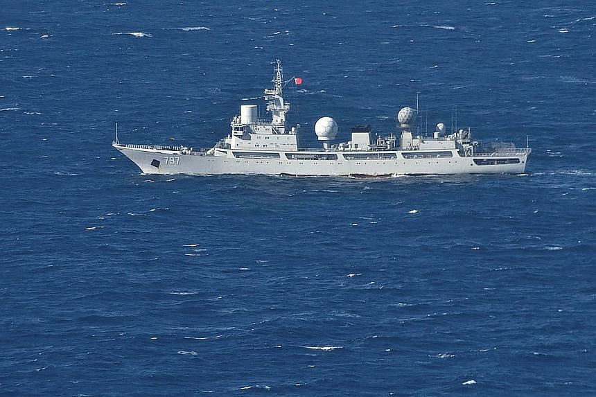 A second vessel is set to join a larger Chinese auxiliary general intelligence ship (right), seen here travelling through the Arafura Sea on July 11, and is being monitored by Australia's defence force.