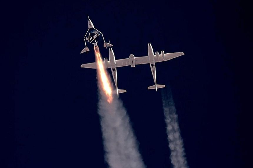 A still image taken from a video made available by Virgin Galactic shows SpaceShipTwo's Unity 22 (left) heading towards space after separating from the carrier plane (right) above Spaceport America, in New Mexico, on July 11. PHOTO: EPA-EFE