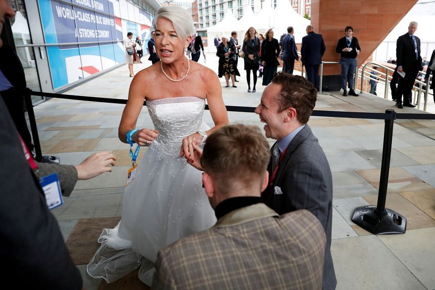 Katie Hopkins arrives dressed in a wedding dress at the Conservative Party's conference in Manchester, Britain on Oct 2, 2017.