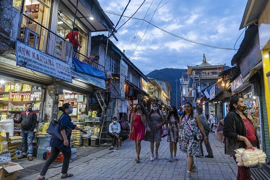 Tourists at the McLeod Ganj hill station in Dharamshala in India's Himachal Pradesh state, on July 1, 2021.