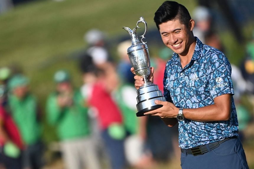 US golfer Collin Morikawa with the Claret Jug after winning the 149th British Open at Royal St George's, Sandwich on July 18, 2021.