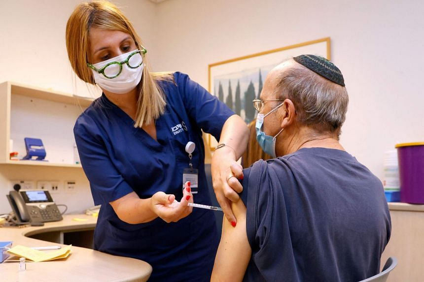 A man receives a third dose of the Pfizer-BioNTech Covid-19 vaccine at the Sheba Medical Centre in Israel, on July 12, 2021.