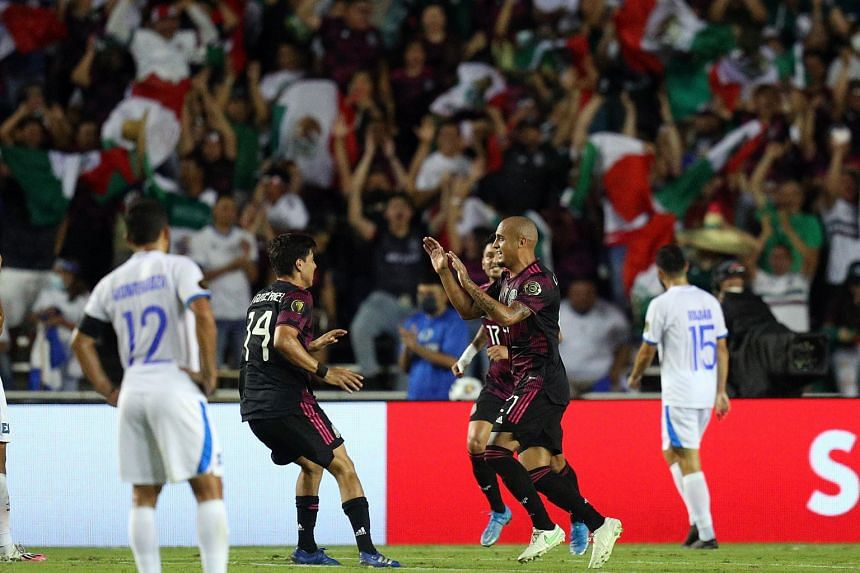 Mexico edged El Salvador 1-0 to claim top spot in Group A.