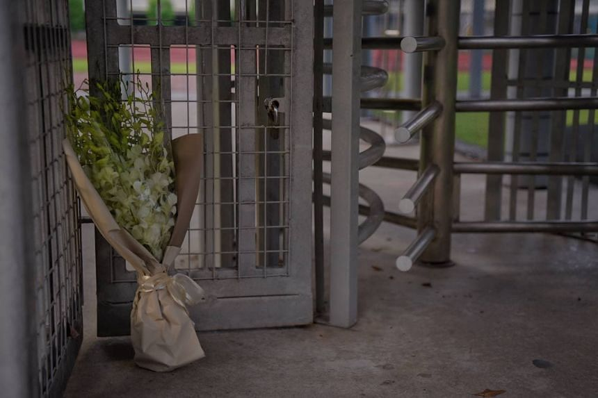 A bouquet of flowers left at the back gate of River Valley High School on July 19, 2021.