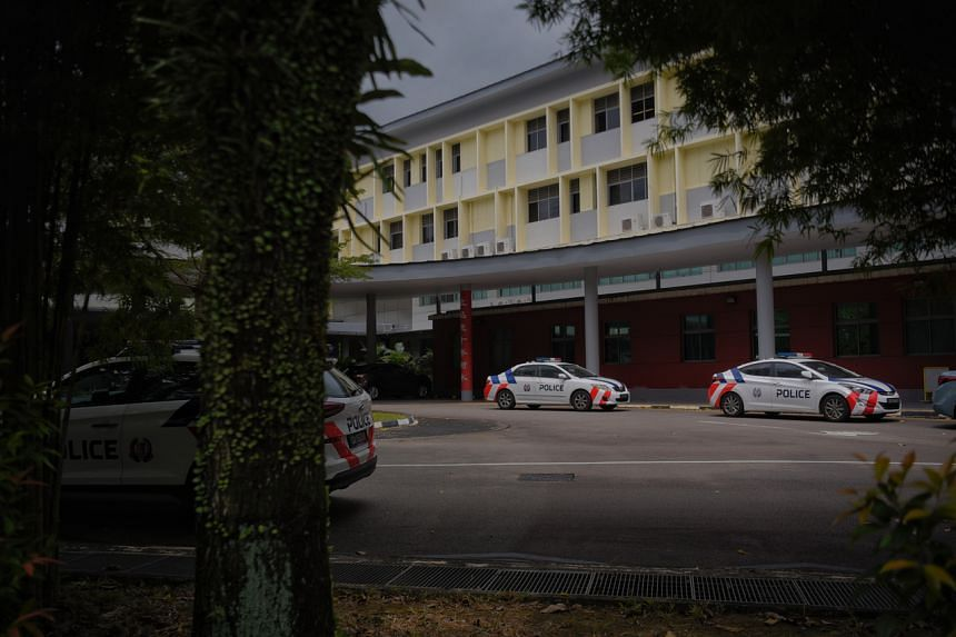 Police cars are seen parked inside River Valley High School on July 19, 2021.
