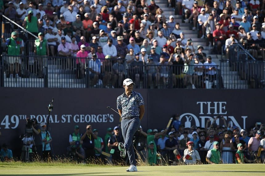 American golfer Collin Morikawa reacting on the 18th green at the British Open on Sunday. The 24-year-old won by two strokes with a 15-under 265 total and is the first men's player to win two different Majors in his first appearance.