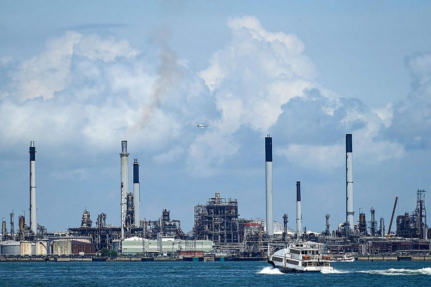 Shell opened Singapore's first oil refinery on Bukom Island (above) in 1961, and four more plants were added over the next few decades. Exxon Mobil's antecedents followed, including a refinery on the nearby island of Ayer Chawan, now part of the Juro