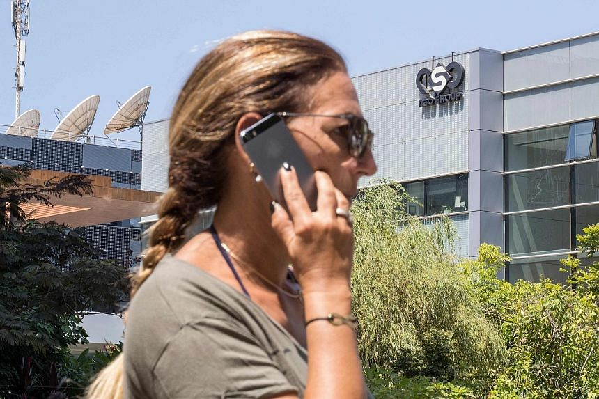 A woman outside the building housing the NSO Group in Israel. A journalism consortium says NSO Group's surveillance application appears to have been used to attempt to hack at least 37 smartphones owned by journalists from various countries. PHOTO: A