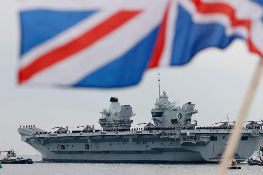 HMS Queen Elizabeth aircraft carrier at the Portsmouth Naval Base in England, on May 1, 2021.
