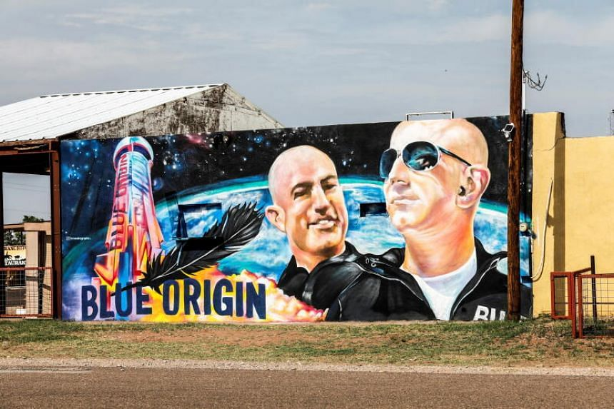 A mural displaying Jeff Bezos and his brother Mark Bezos, is seen in Van Horn, Texas, before the launch of Blue Origin's inaugural flight.