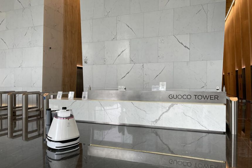 Cleaning robots have been deployed at Guoco Tower in the Tanjong Pagar area to disinfect floors and maintain safety and cleanliness standards.
