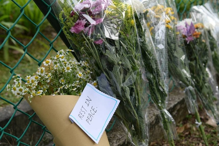 Flowers placed outside River Valley High School on July 20, 2021.