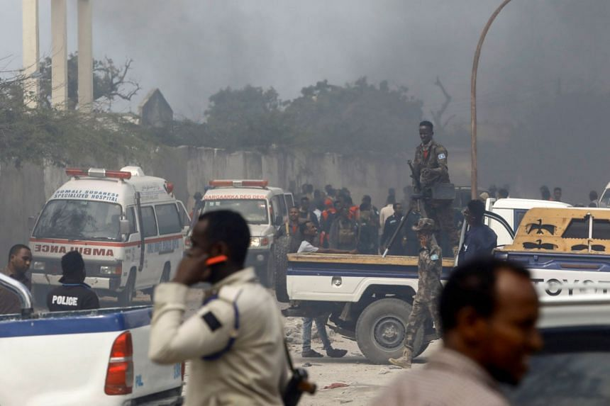 A general view shows security officers and rescuers at the scene of a car explosion claimed by Al-Shabaab in Somalia's capital Mogadishu, on July 10, 2021.