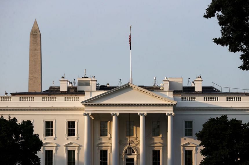 The official is staying away from the White House (above) and contact tracing has been carried out.