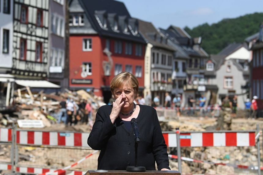 German Chancellor Angela Merkel reacts as she addresses a media conference during a visit to flood-stricken Bad Muenstereifel, Germany on July 20, 2021.