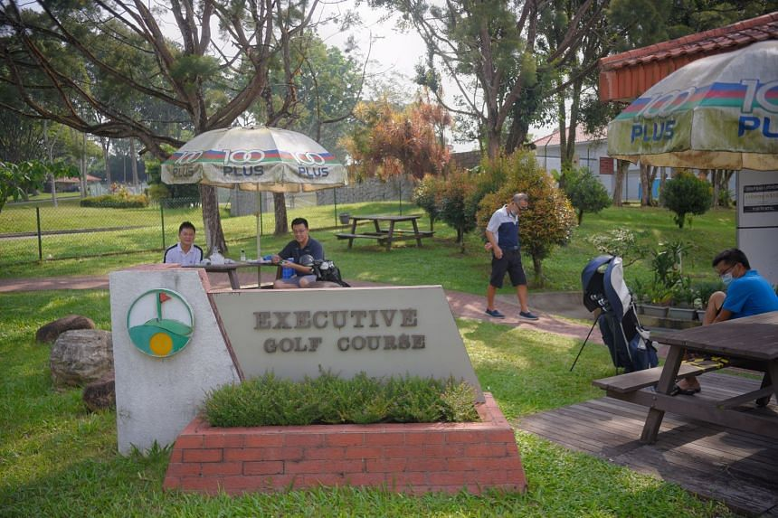 Golfers are seen outside the clubhouse of the Mandai Executive Golf Course on 12 June, 2021.