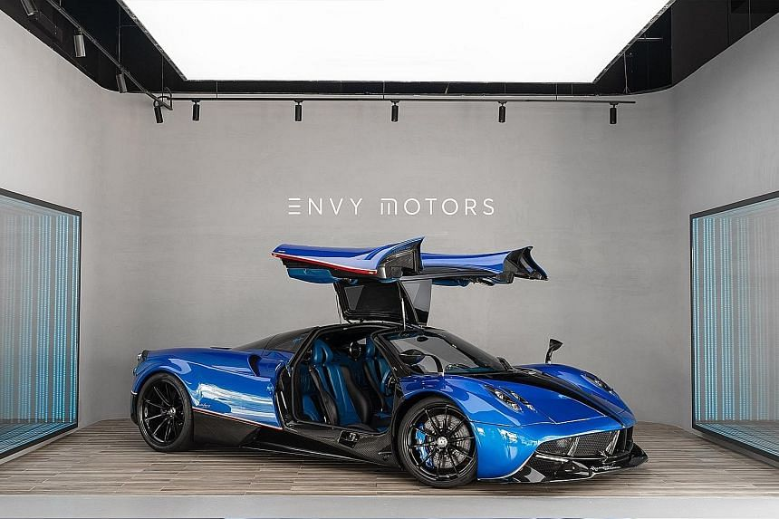 FRONT FOR FRAUD Investors would enter into agreements with Ng's Envy Global Trading (above) or Envy Asset Management to fund purported nickel purchases. LAVISH LIFESTYLE A rare multimillion-dollar Pagani Huayra hypercar was among Ng's assets seized b