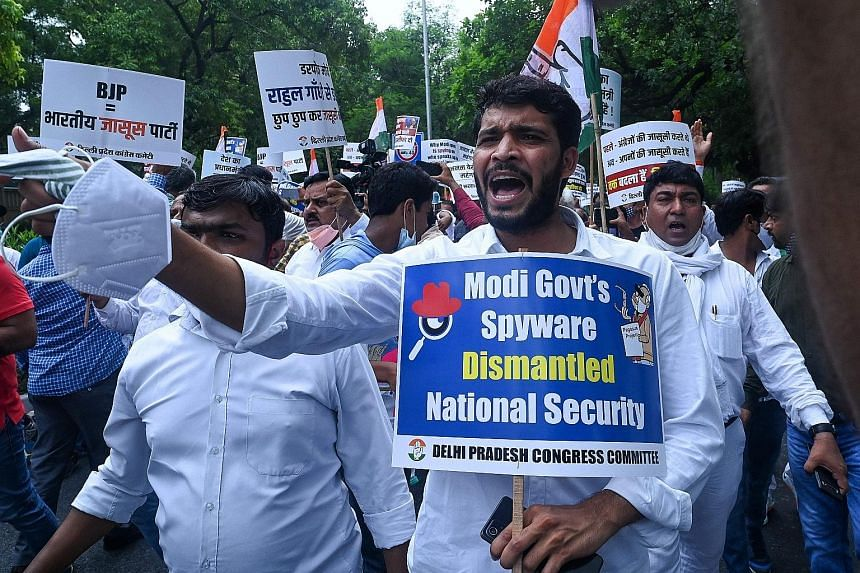 India's Congress party members protesting in New Delhi yesterday against Prime Minister Narendra Modi's government over its alleged surveillance operation using the Pegasus spyware.
