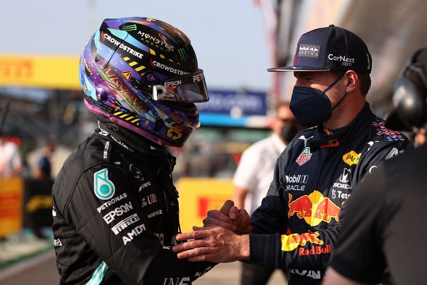 Lewis Hamilton (left) and Max Verstappen shake hands after the sprint qualifying session at the Silverstone motor racing circuit on July 16, 2021.