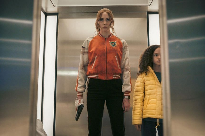 A still from the film Gunpowder Milkshake starring Karen Gillan (left) and Chloe Coleman.
