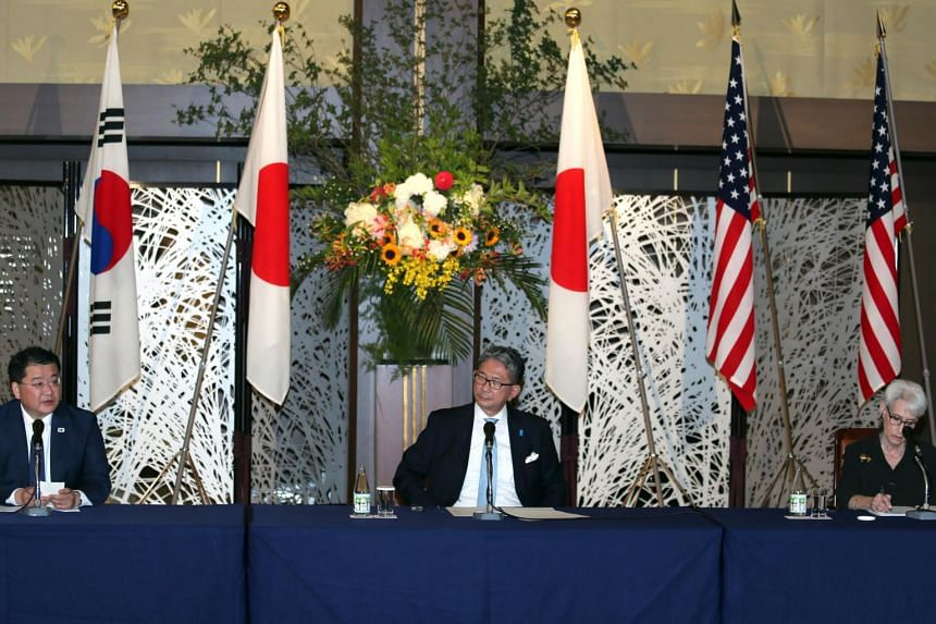 Japanese vice-foreign minister Takeo Mori, US Deputy Secretary of State Wendy Sherman and South Korea's vice-foreign minister Choi Jung-kun in Tokyo, on July 21.