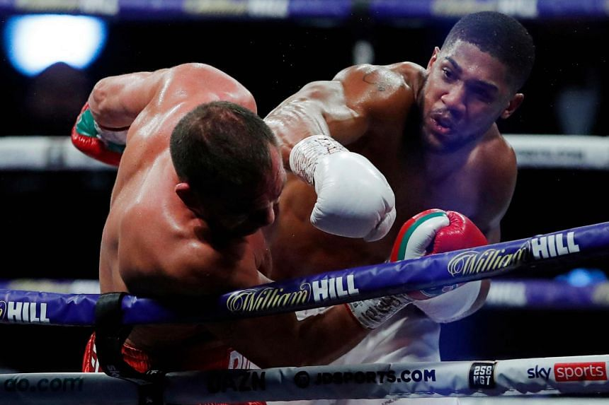 A 2020 photo shows Britain's Anthony Joshua (right) landing a punch on Bulgaria's Kubrat Pulev during their heavyweight world title match in London.
