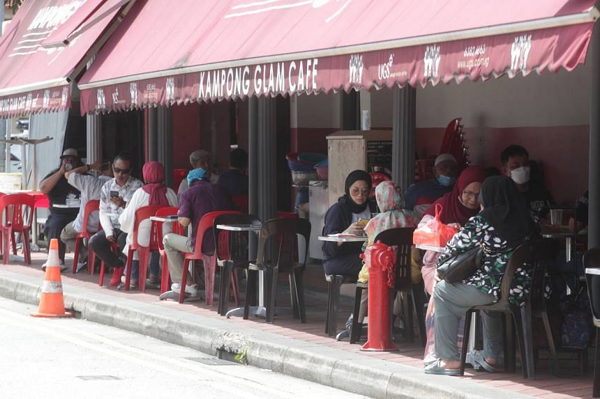 Diners seen dining in along Baghdad Street on July 21, 2021.