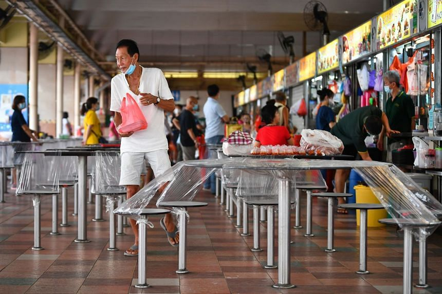 A June 2021 photo shows a man leaving with his takeaway food at Chong Boon Market and Food Centre.