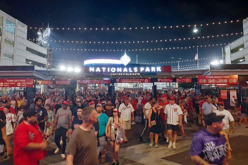 People are seen leaving Nationals Park stadium after a shooting occurred outside the premises in Washington, DC, on July 17, 2021.