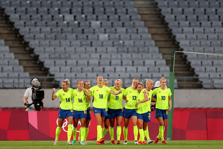 Sweden celebrates scoring their second goal in a game against the United States at the Tokyo Stadium on July 21, 2021.