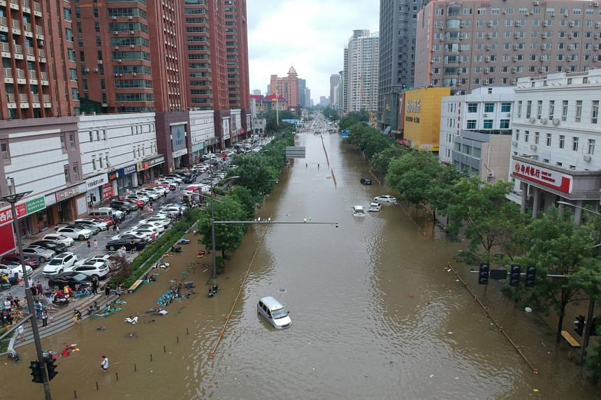 An aerial view shows a flooded road section following heavy rainfall in Zhengzhou, China on July 21, 2021.