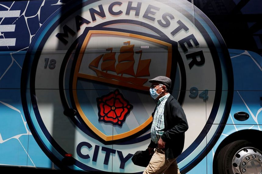 A man walks past a Manchester City team bus in Porto ahead of the Champions League final.