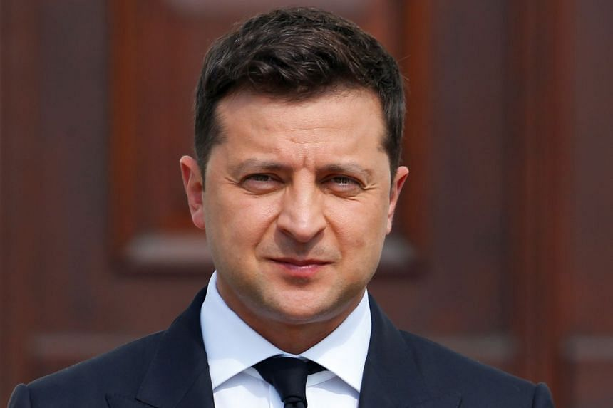 Ukrainian President Volodymyr Zelenskiy poses as he is welcomed at the Bellevue palace in Berlin, Germany, on July 12, 2021.