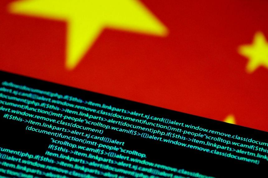 An illustration photo shows computer code on a screen above a Chinese flag.